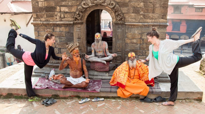sadhus with two yogis