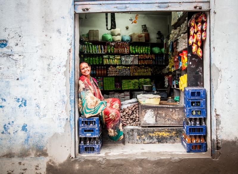 Store Woman sitting on coke bottles