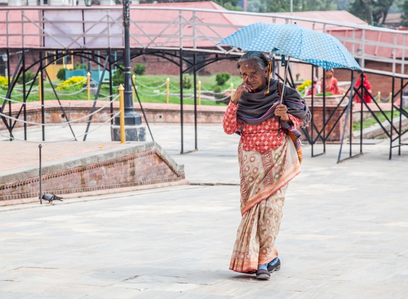 Woman with umbrella, Pashupati-2
