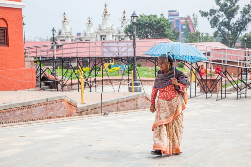 Woman with umbrella, Pashupati-3