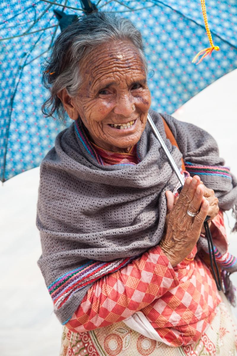Woman with umbrella, Pashupati-4