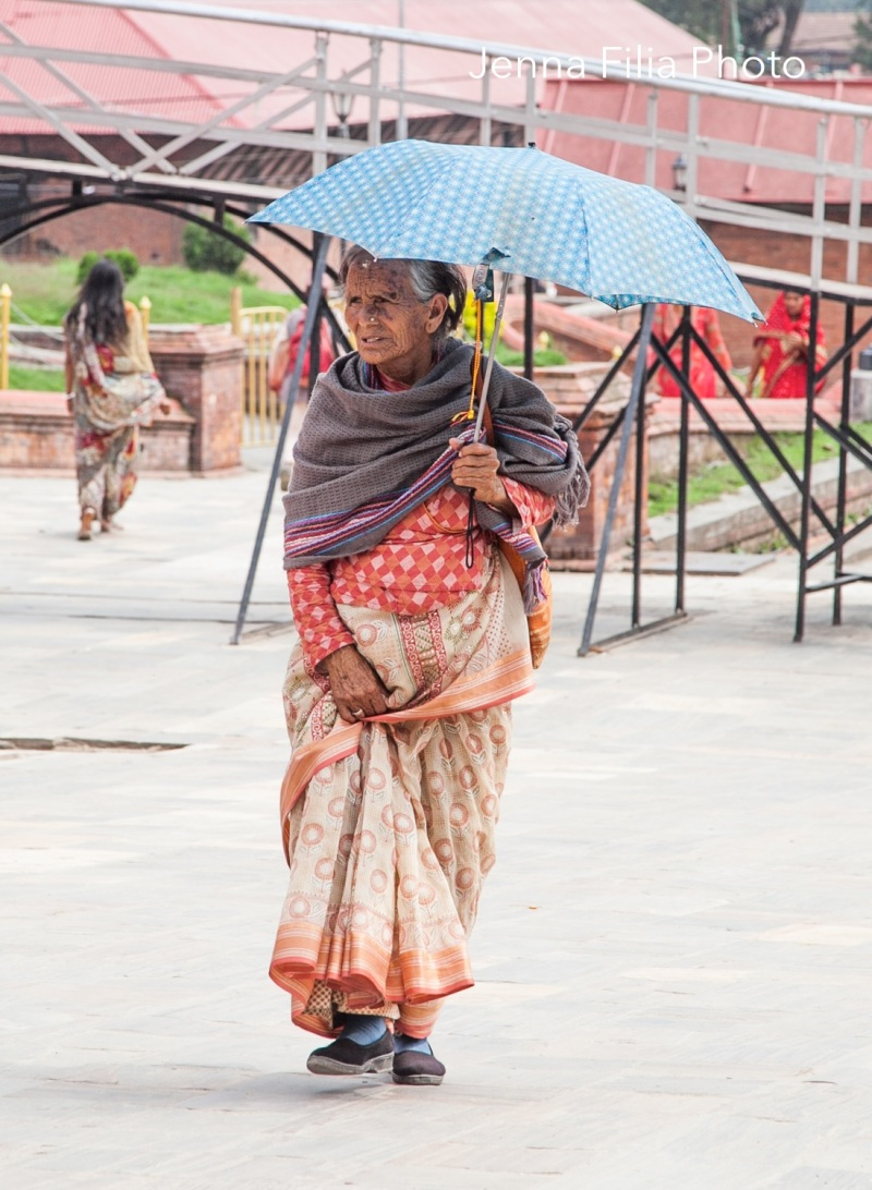 Woman with umbrella, Pashupati