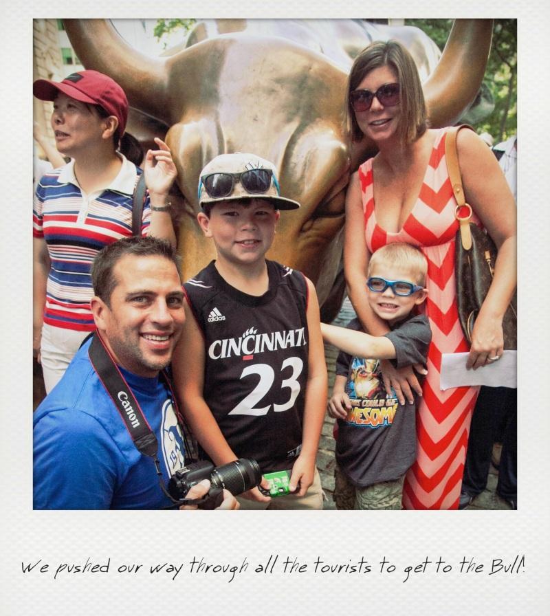 family in front of bull