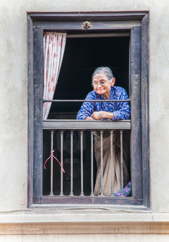old woman in window