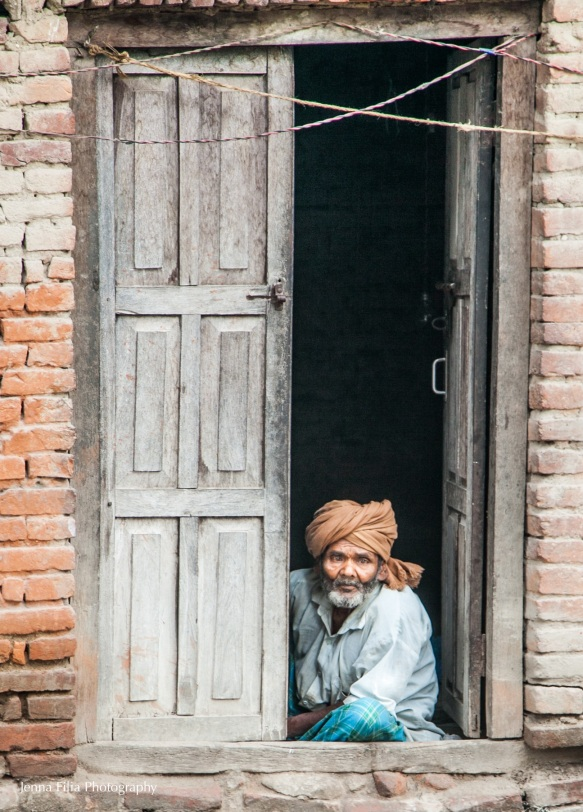 Use-Man in doorway with head wrapped-2